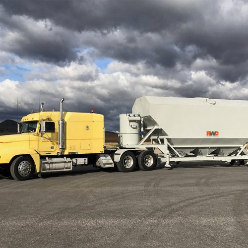 Low profile portable silo in transit