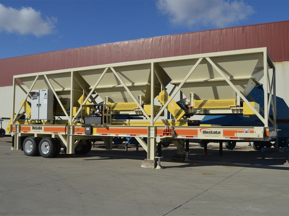 Portable blending hopper on display at manufacturing plant