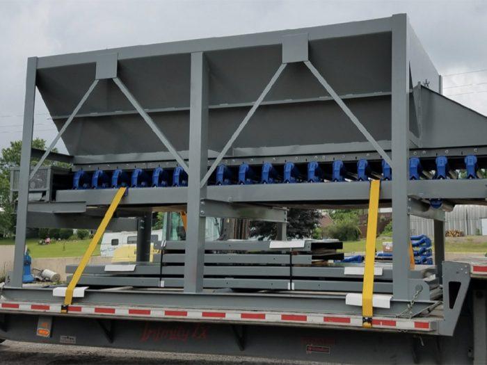 Skid mounted portable feeder bin ready for transport